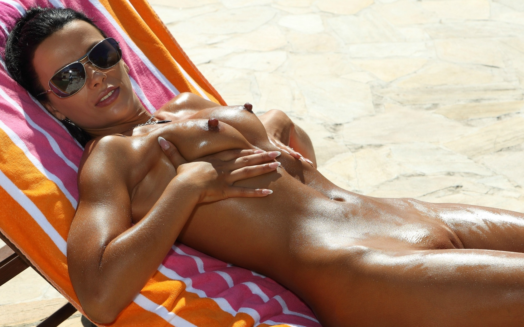 Sexy milf tanning topless