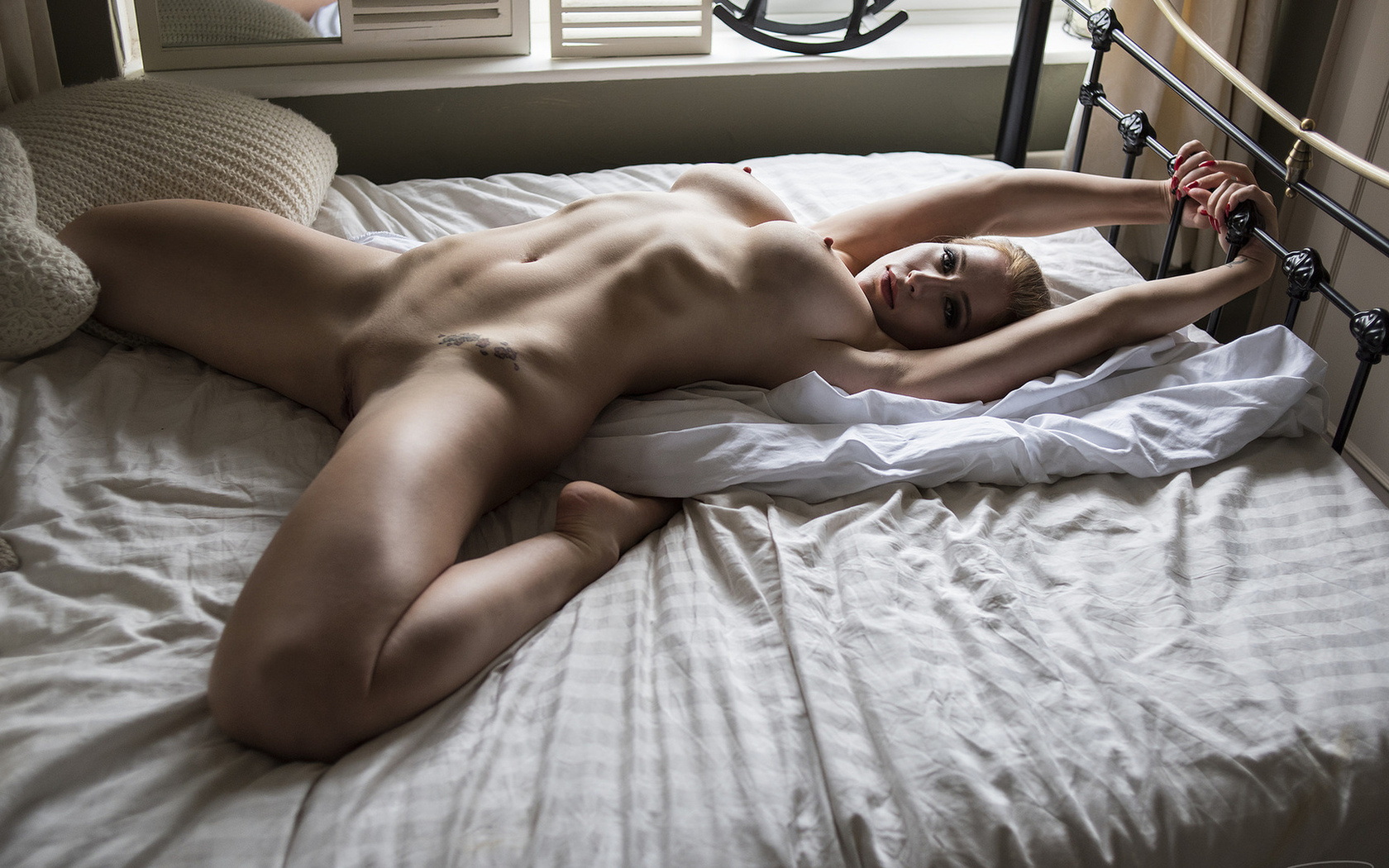 naked-girl-on-boy-in-bed