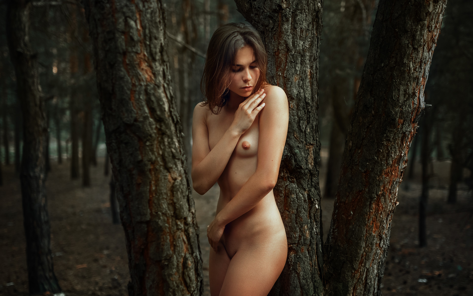 Photo of nude woman walking in a forest by a river in nature