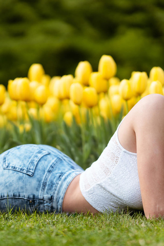 women, jean shorts, grass, high heels, feet in the air, women outdoors, tulips, lying on front