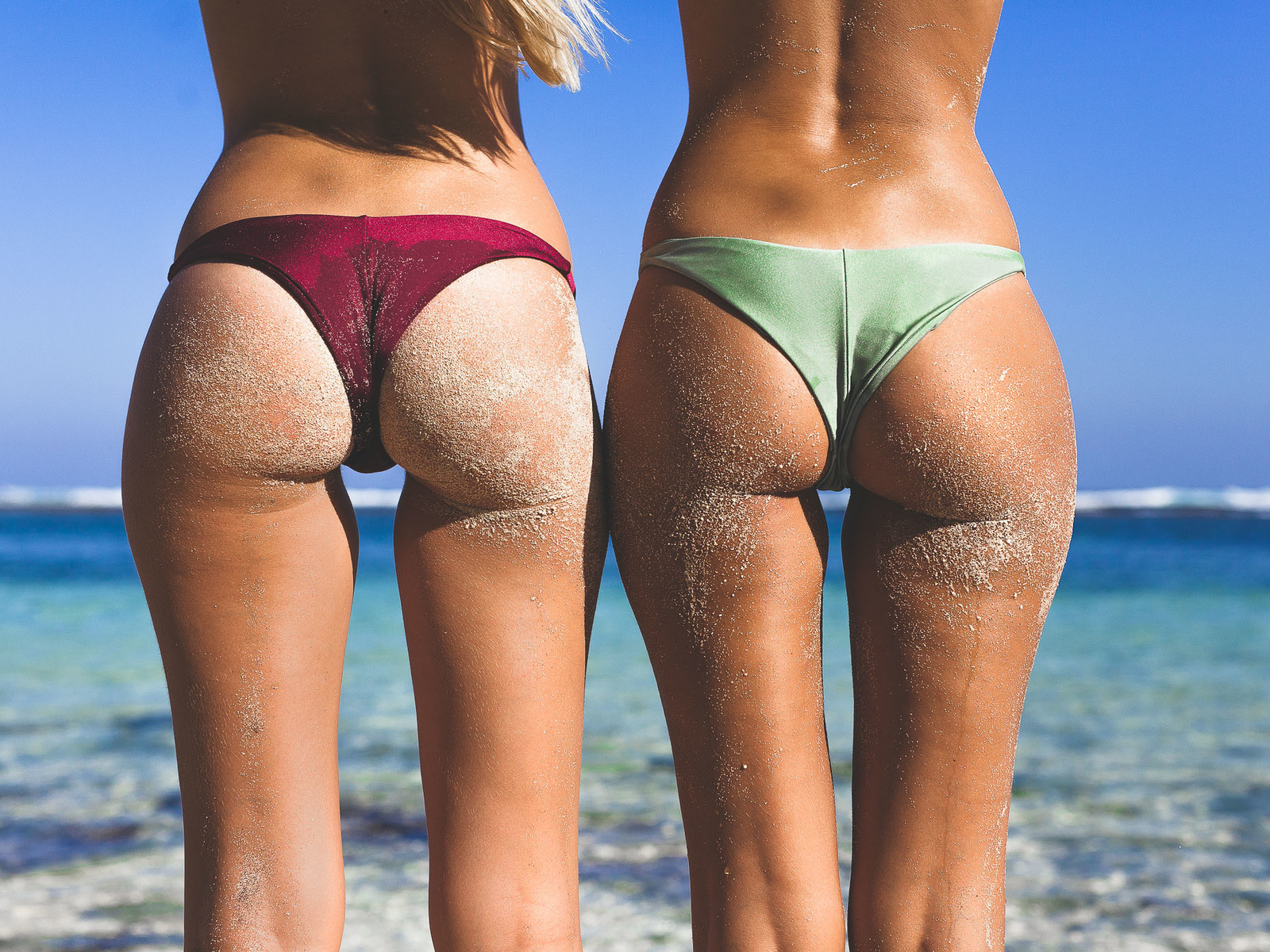 two girls, asses